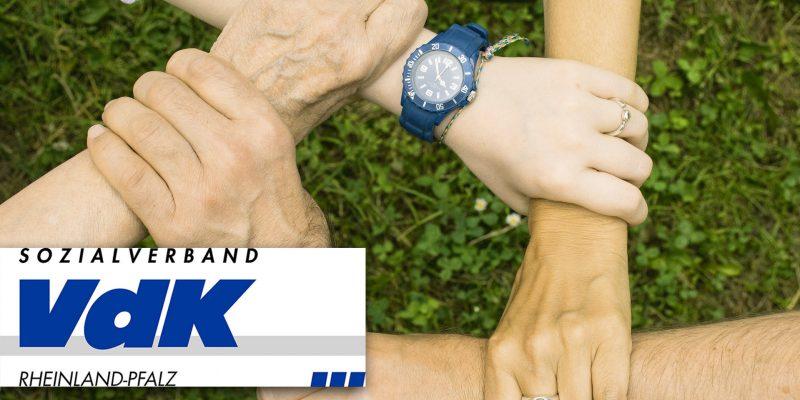 5 sich zusammen haltende Hände mit vdk logo